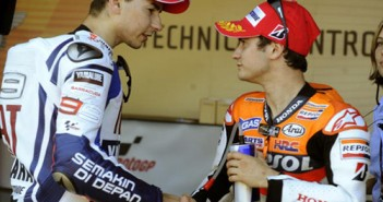 Honda's Spanish Dani Pedrosa (R) is cong