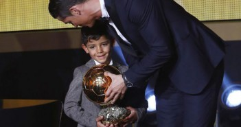 Real Madrid's Ronaldo stands with his son Cristiano Ronaldo Jr after winning FIFA Ballon d'Or 2014 in Zurich