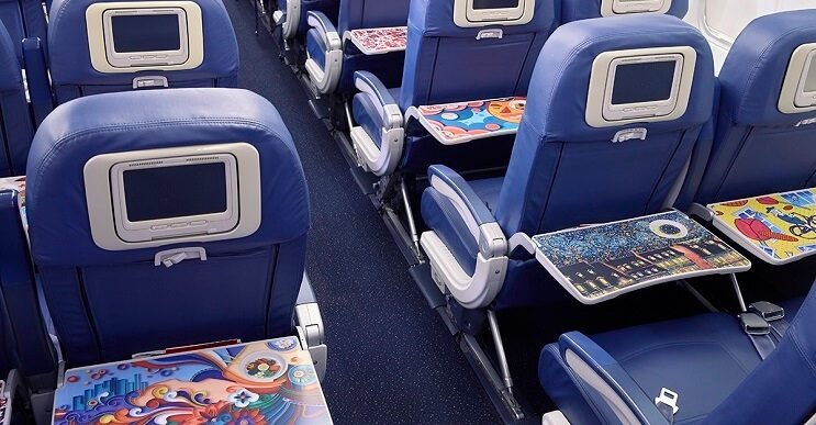 Aerolínea-Delta-y-Coca-Cola-llevan-arte-por-los-aires-asientos